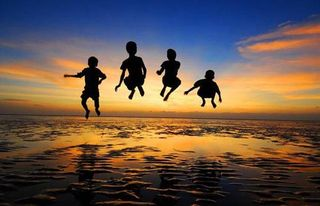 Children_jumping_into_air_